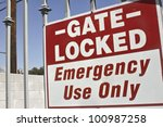 Gate is lock for emergency use only. - stock photo