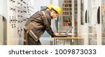 two maintenance engineers... | Shutterstock . vector #1009873033