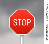 red stop sign on gray sky... | Shutterstock .eps vector #1009907677