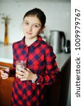 adorable kid girl in plaid red... | Shutterstock . vector #1009979767