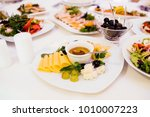 cheese platter and salad on the ... | Shutterstock . vector #1010007223