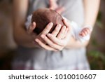 mom keeps her newborn baby in... | Shutterstock . vector #1010010607