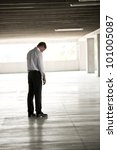 Depressed Businessman In Undeground Parking - stock photo