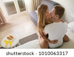 playful couple affectionate in... | Shutterstock . vector #1010063317