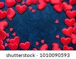 red hearts on dark background... | Shutterstock . vector #1010090593