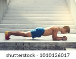 athletic build man doing plank... | Shutterstock . vector #1010126017