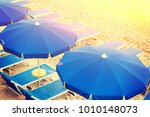 blue empty sunbeds with... | Shutterstock . vector #1010148073