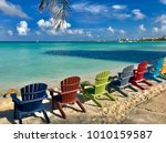 colorful wooden chairs on the...   Shutterstock . vector #1010159587