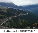 curving mountain rood going... | Shutterstock . vector #1010196397