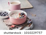 muesli with berries and a cup... | Shutterstock . vector #1010229757