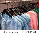 row of female  colorful sweater ... | Shutterstock . vector #1010231923