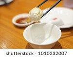xiao long pao  dumpling being... | Shutterstock . vector #1010232007