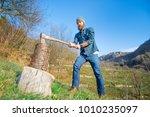 lumberjack cut trunk with dark... | Shutterstock . vector #1010235097