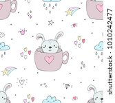 vector pattern with rabbit and... | Shutterstock .eps vector #1010242477
