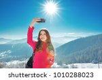 happy woman shooting in the top ...   Shutterstock . vector #1010288023