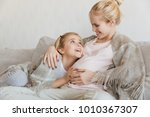 happy daughter touching... | Shutterstock . vector #1010367307