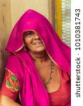 Small photo of Rishikesh, India - 11/03/2017: Portrait of a wise looking Indian elderly woman in traditional saree dress