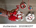 Small photo of Martenitsa, white and red strains of yarn, Bulgarian folklore tradition, welcoming the spring in March, adornment symbol, wish for good health. Baba Marta Day. UNESCO List Cultural Heritage Humanity.