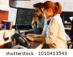 two programmers working on new... | Shutterstock . vector #1010413543