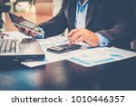 a businessman analyzing... | Shutterstock . vector #1010446357