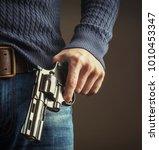 the gun in  hands | Shutterstock . vector #1010453347