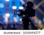 tv camera in a concert hall... | Shutterstock . vector #1010454277