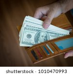 wallet with us dollars in the... | Shutterstock . vector #1010470993