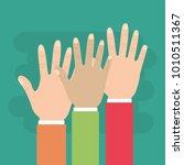 human hands raised multiethnic... | Shutterstock .eps vector #1010511367