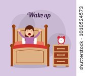 girl in his bed with clock... | Shutterstock .eps vector #1010524573