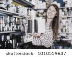 positive salesgirl suggesting... | Shutterstock . vector #1010559637