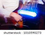 guitarist plays the guitar in... | Shutterstock . vector #1010590273