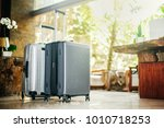 two gray large suitcases stand...   Shutterstock . vector #1010718253