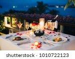 romantic candlelight dinner... | Shutterstock . vector #1010722123