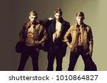 three handsome muscular men or... | Shutterstock . vector #1010864827