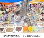merchants sell nepalese... | Shutterstock . vector #1010938663