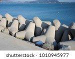 concrete block breakwater hit... | Shutterstock . vector #1010945977