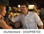 handsome young man smiling... | Shutterstock . vector #1010958733