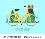 welcome spring. yellow bicycle... | Shutterstock .eps vector #1010961133