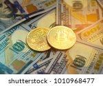 golden metal bitcoin pair and... | Shutterstock . vector #1010968477
