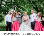 newlyweds and their friends... | Shutterstock . vector #1010986477