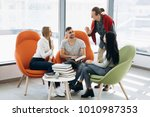 students work on the project... | Shutterstock . vector #1010987353