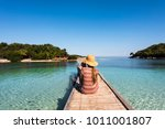 ksamil beach   woman with straw ... | Shutterstock . vector #1011001807
