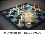 gold and silver chessmen on... | Shutterstock . vector #1011049603