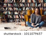 Young Woman Writer In Library...