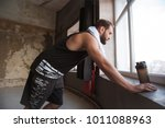sporty active tired man staying ... | Shutterstock . vector #1011088963