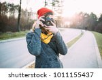 young woman with retro camera...   Shutterstock . vector #1011155437