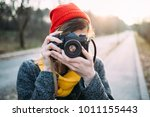 girl photographing with retro...   Shutterstock . vector #1011155443