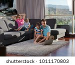young happy family relaxing at... | Shutterstock . vector #1011170803