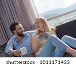 young couple relaxing at  home... | Shutterstock . vector #1011171433