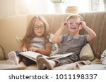 brother and sister reading a... | Shutterstock . vector #1011198337